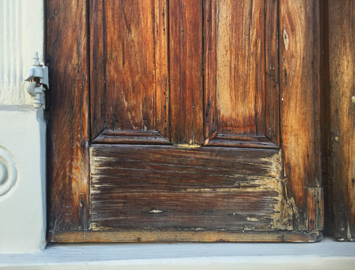 Rehabilitated historic cypress wood door in the French Quarter
